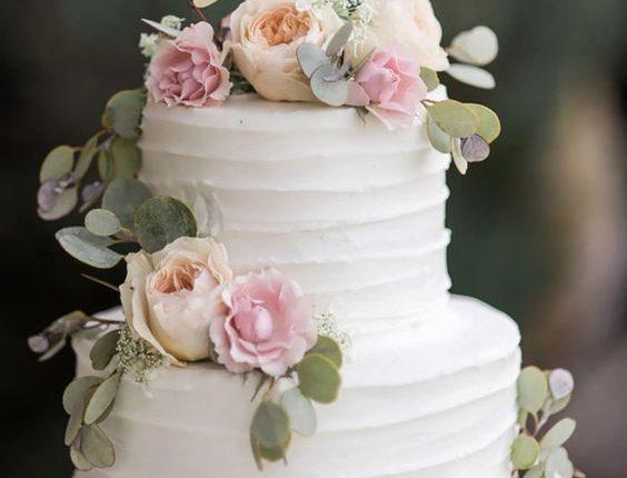 Floral white buttercream wedding cake