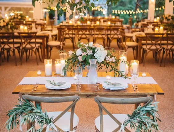 Lush sweetheart table with greenery galore