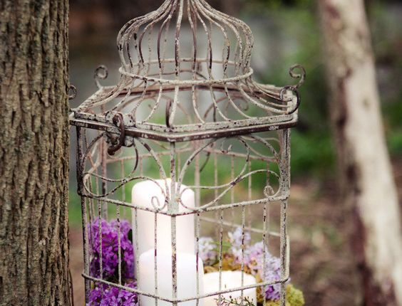 Purple candle and birdcgae wedding decor