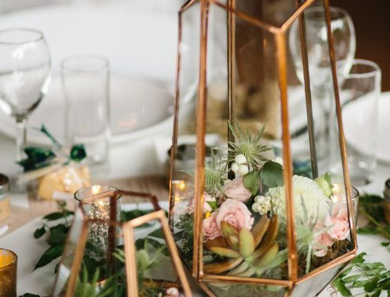Terrarium centerpiece in mixed metallics with small floral and succulents
