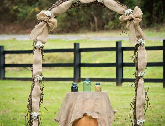 Wine Barrell Grapevine Arch with Burlap and Baby's Breath
