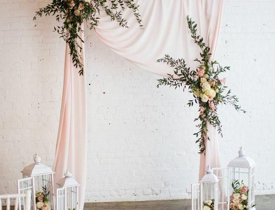 draped wedding arch by Blossom Farm Vintage Rentals