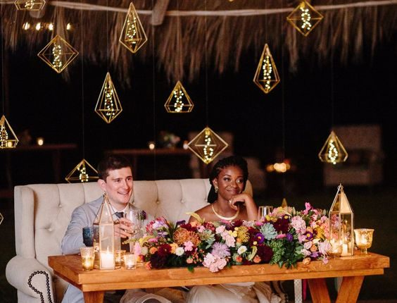 hanging lights behind the sweetheart table