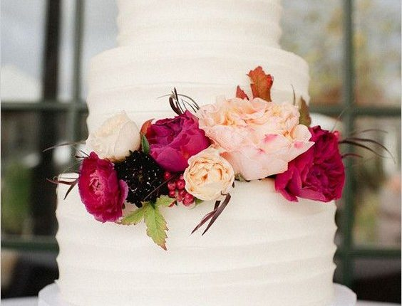 rustic white buttercream wedding cake with deep red flwoers