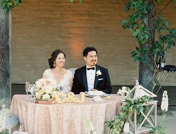 rustic wood lanterns and greenery wedding head table decor