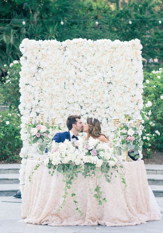 Lush greenery floral wall wedding backdrop