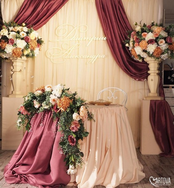 luxury burgundy and blush fall indoor wedding sweetheart table