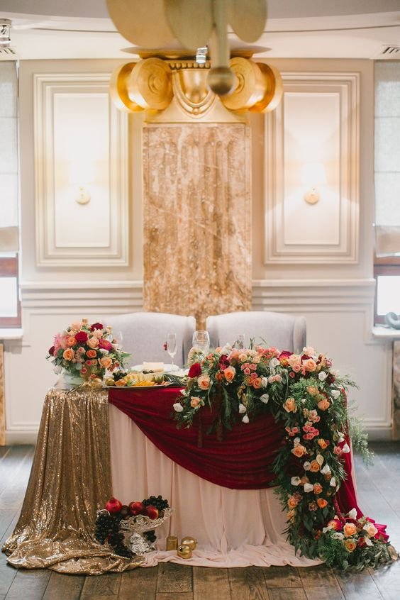 luxury burgundy and gold wedding sweetheart table