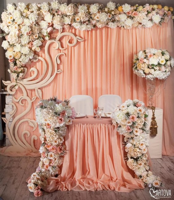 luxury coral pink sweetheart table for wedding