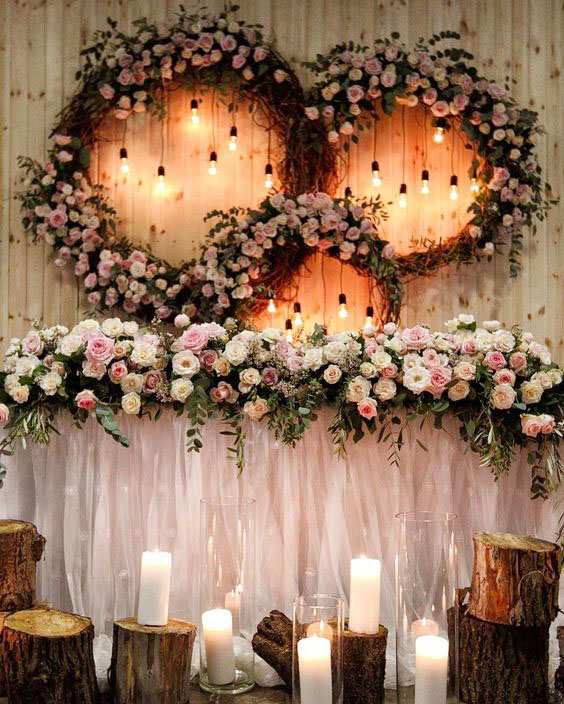 rustic luxury roses and tree stump wedding sweetheart table