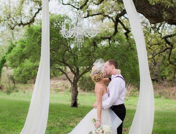 draped fabric in the tree wedding backdrop