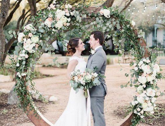 garden floral and wood circular wedding arch