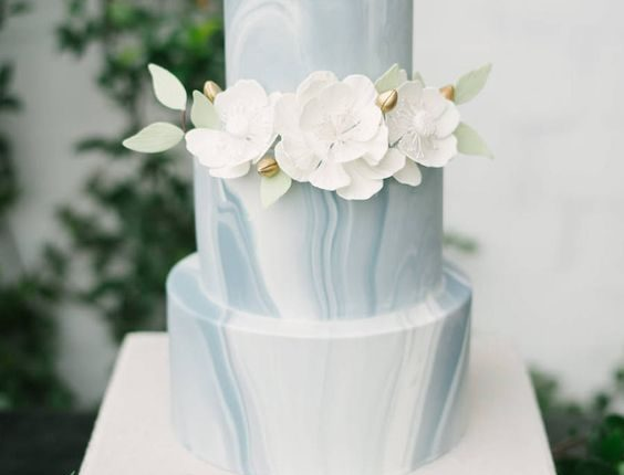 Blue Grey and White Marble Three Tiered Minimalist Wedding Cake with Ivory Sugar Flowers with Green Leaf Accent