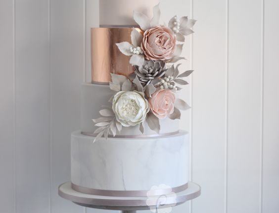 Modern rose gold marble wedding cake with sugar flowers and succulents
