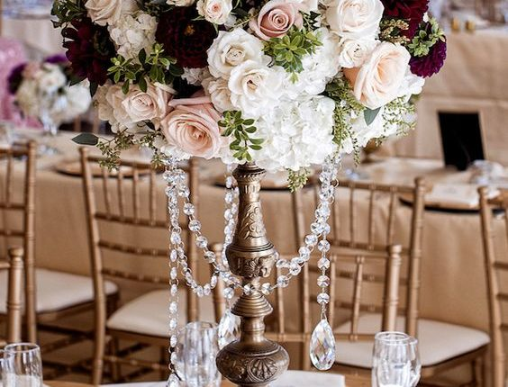 Tall burgundy and blush wedding centerpiece