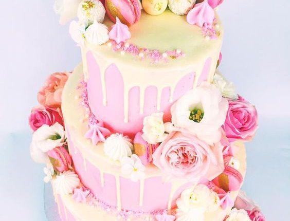 Yellow and pink drip wedding cake