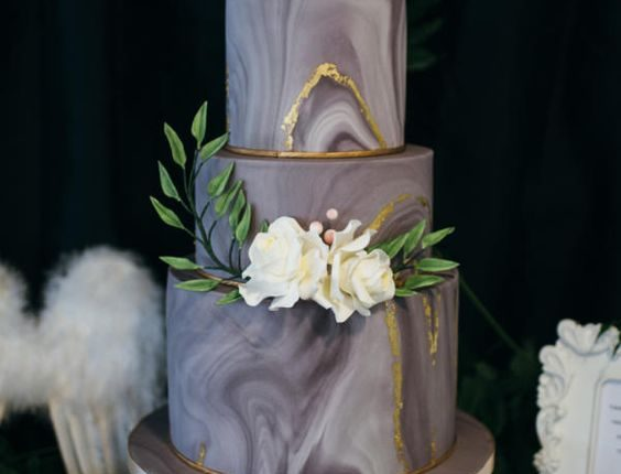 grey and gold marble wedding cake with ivory sugar flowers