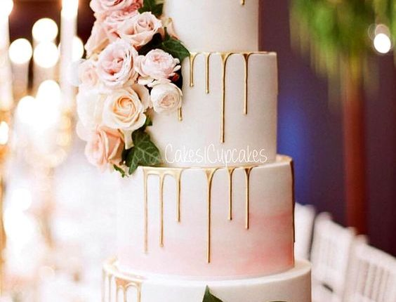 pink drip wedding cake with roses