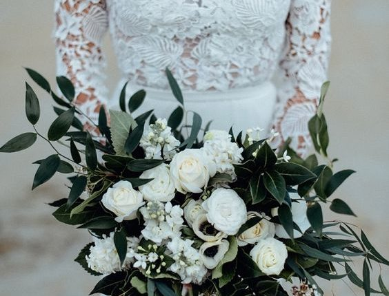 white roses and greenery wedding bouquet