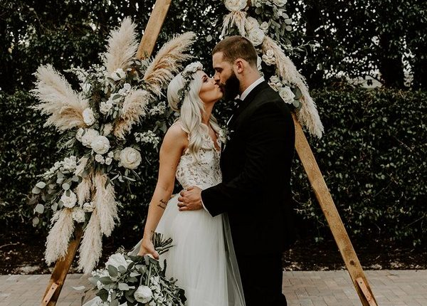 Bohemian Sage Green Eucalyptus Wedding Arch with Pampas Grass Details