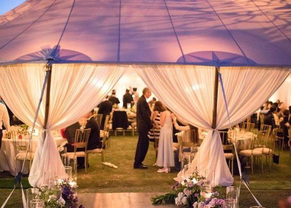 Outdoor romantic wedding tent lighting and layout idea