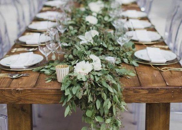 seeded eucalyptus and white flowers wedding garland centerpiece