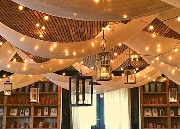 barn wedding reception decor with draping fabric