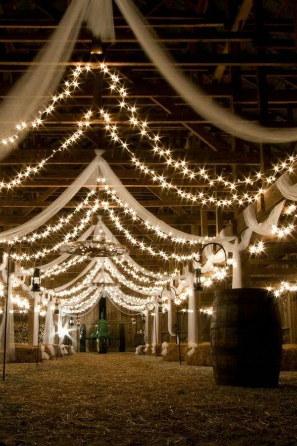 barn wedding reception ideas with draping fabric and lighting