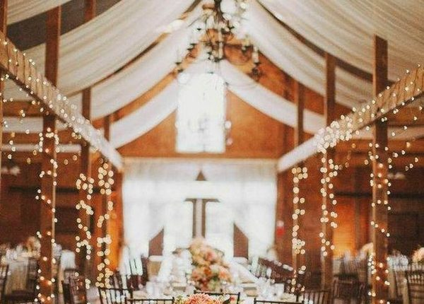 barn wedding reception ideas with lights and fabric