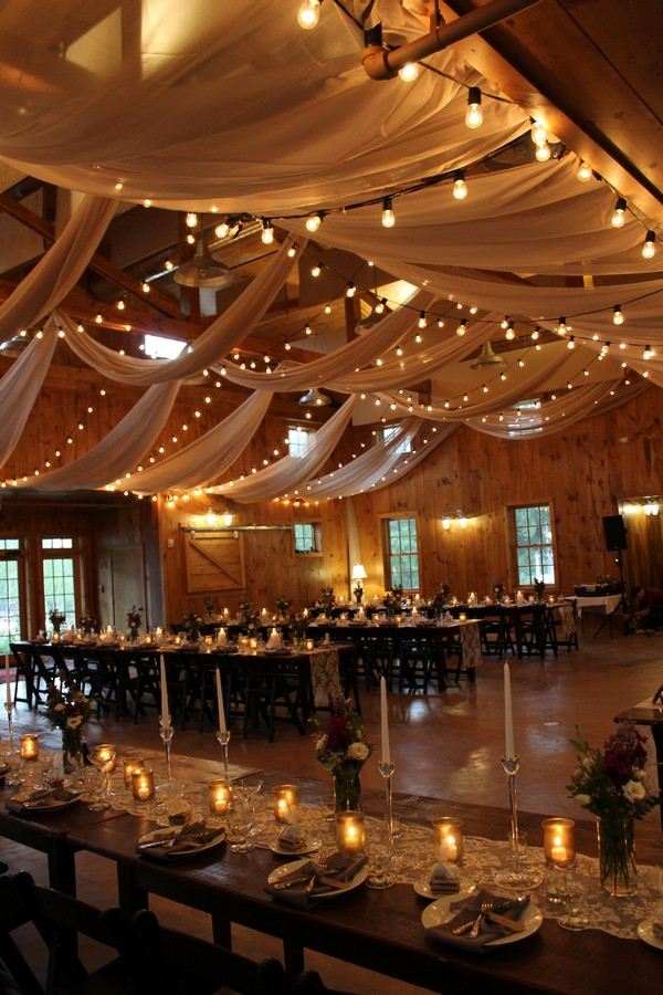 country barn wedding reception ideas with fabric and lighting