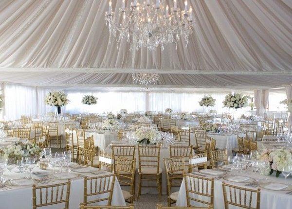 elegant romantic chandelier with dramatic draping tent wedding decor