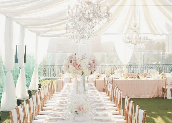 elegant tent wedding reception with ivory draping fabric