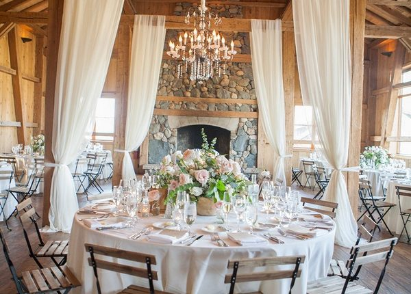 rustic barn wedding reception with fabric draping