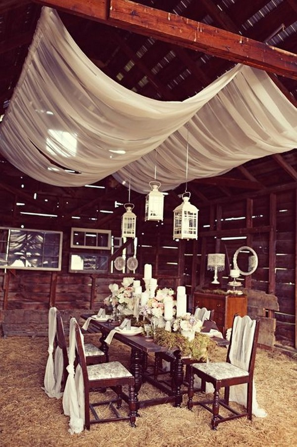 vintage barn wedding decor with suspended hurricane lanterns