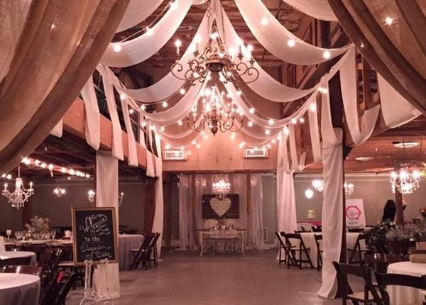 vintage barn wedding reception ideas with draping fabric