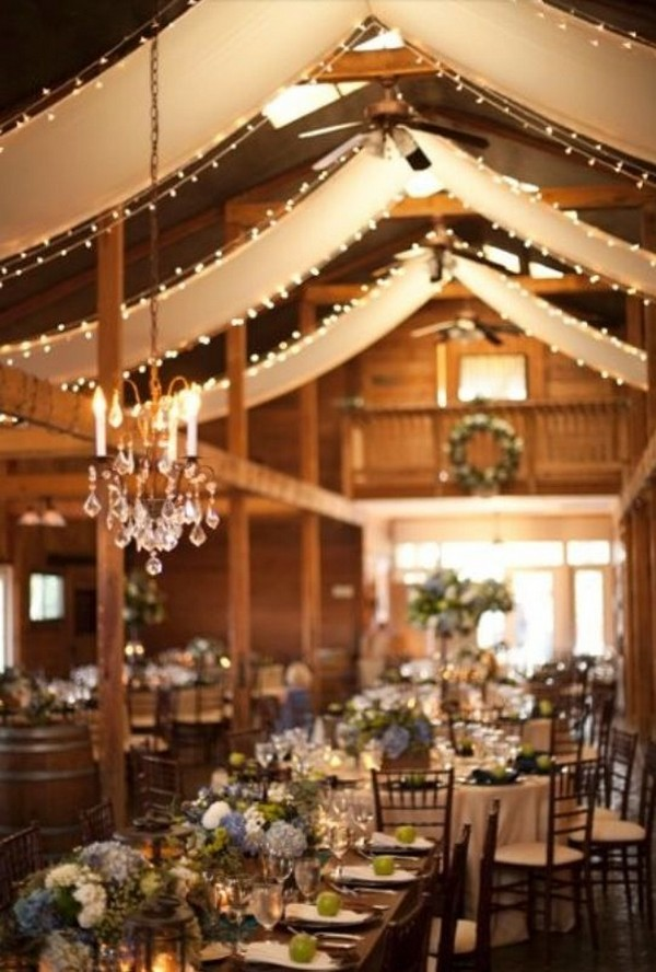 vintage barn wedding reception ideas with draping fabric and lighting