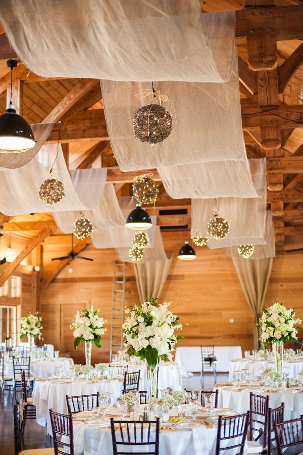 vintage barn wedding reception with draping fabric and lighting