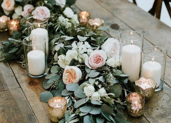 Greenery wedding centerpiece with candles