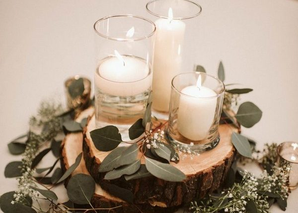 Wedding table styling with white candles and eucalyptus
