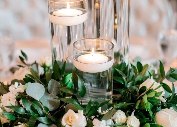 White roses, white spray roses, white stock, rusucs and eucalyptus