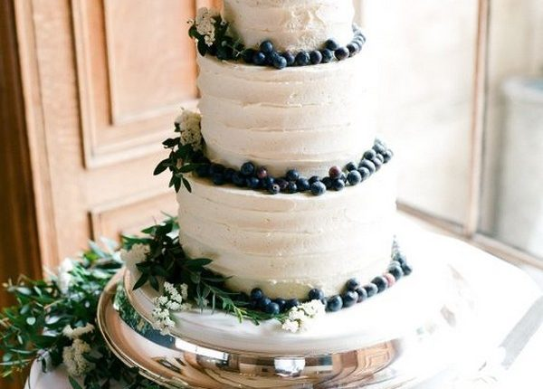 blueberries and greenery simple wedding cake