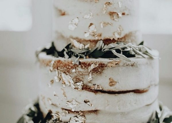 gold speckled sage green leaves decorated naked wedding cakes
