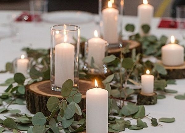 greenery diy wedding centerpiece ideas with candles and tree stumps