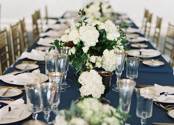 navy blue gold and greenery long table wedding decorations