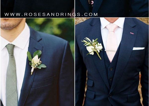 navy blue groom attire and tie and boutonniere