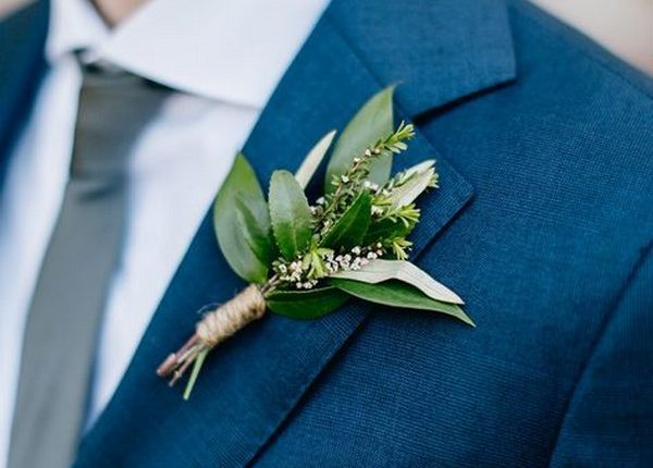 navy blue grooms suit with greenery boutonniere