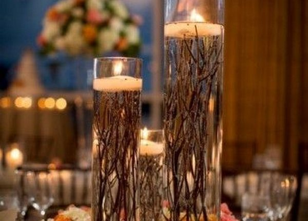 particular centrepiece uses roots instead of petals underneath the candles
