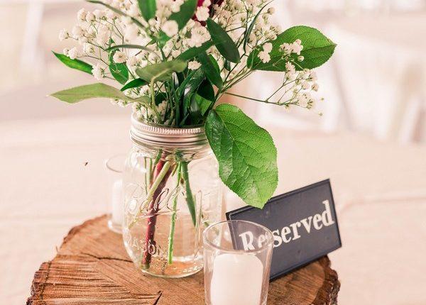 red roses mason jar and tree stump wedding centerpiece