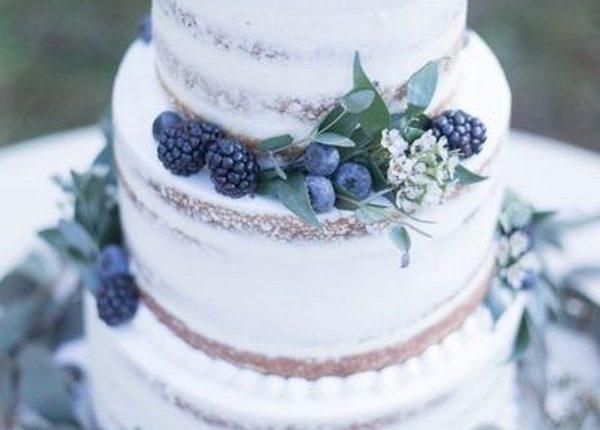 rustic naked blueberry wedding cake