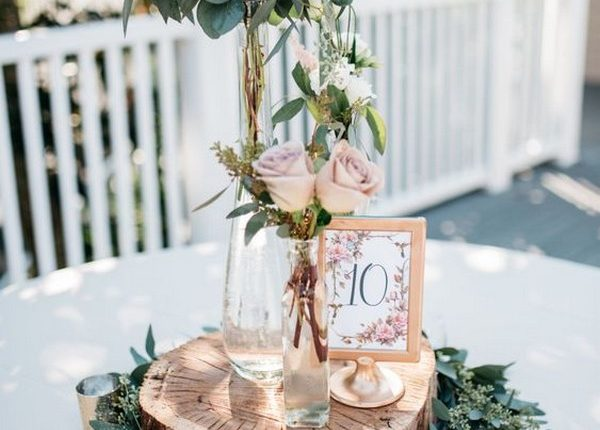 seeded eucalyptus and tree stump wedding centerpiece